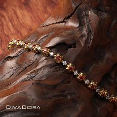Garnet & Diamond Tennis Bracelet in 14K White and Yellow Gold