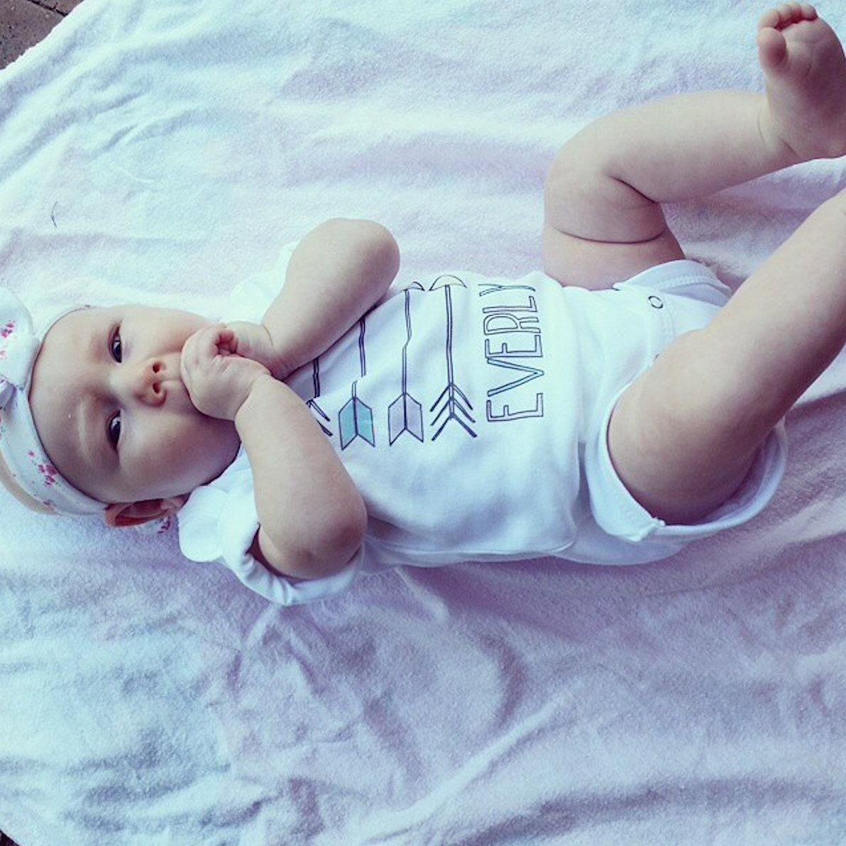 Everly in our Aztec Arrows Baby Name Onesie (customer photo via Instagram @wordonbaby)