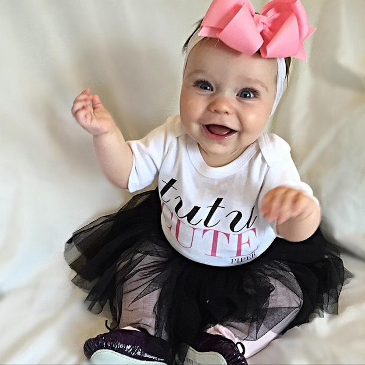 Piper the baby ballerina in her personalised Tutu Cute onesie (via Instagram @pipersienna + @wordonbaby)