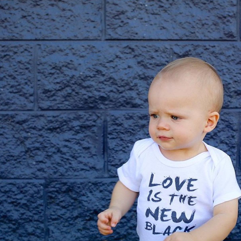 LOVE IS THE NEW BLACK onesie for Oliver - @charlielouisemcfarlane @wordonbaby