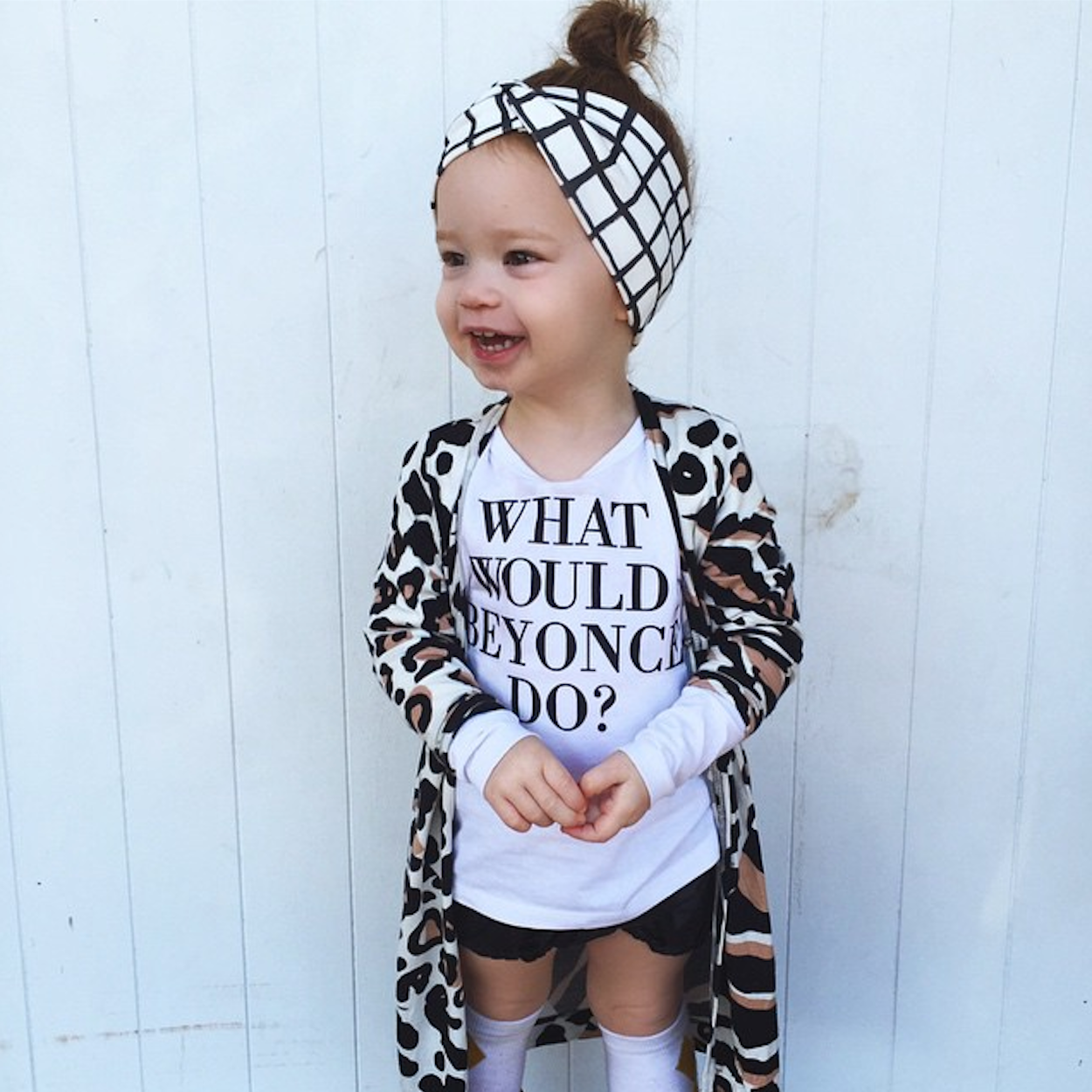 Evie from @sheloveslaughslives looking super stylish in her Word On Baby 'What would Beyonce do?' long sleeve toddler top