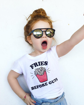 Evie in her FRIES BEFORE GUYS kids tee