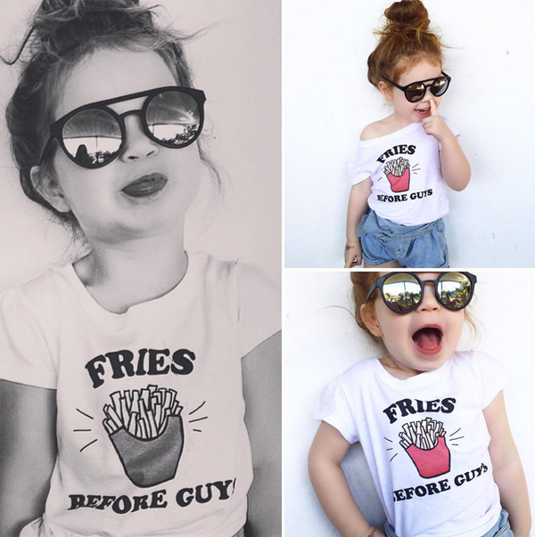 Evie in her girl's tee with the FRIES BEFORE GUYS print