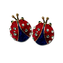 "Red and Blue Enamel and Diamond-like Swarovski Crystals. Approx .75"". Pierced only."