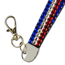 """This patriotic crystal lanyard is sure to be a bestseller. These are great for badge holder and credentials. 15"""" folded. Includes lobster claw closure."""