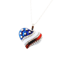 American flag heart shaped pendant/necklace adorned with small diamond like crystals on white and red enamel. The silver stars are mounted on a blue background.