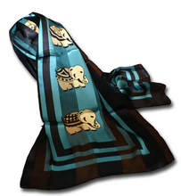 Teal silk scarf with black trimmed border featuring  beige elephants in the center of the design. Excellent accessory for the election season!