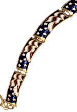 Red, White and Blue enamel bracelet with claw clasp and 4 patriotic links. Goldplate.