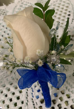White rose, with rhinestone embellishments.