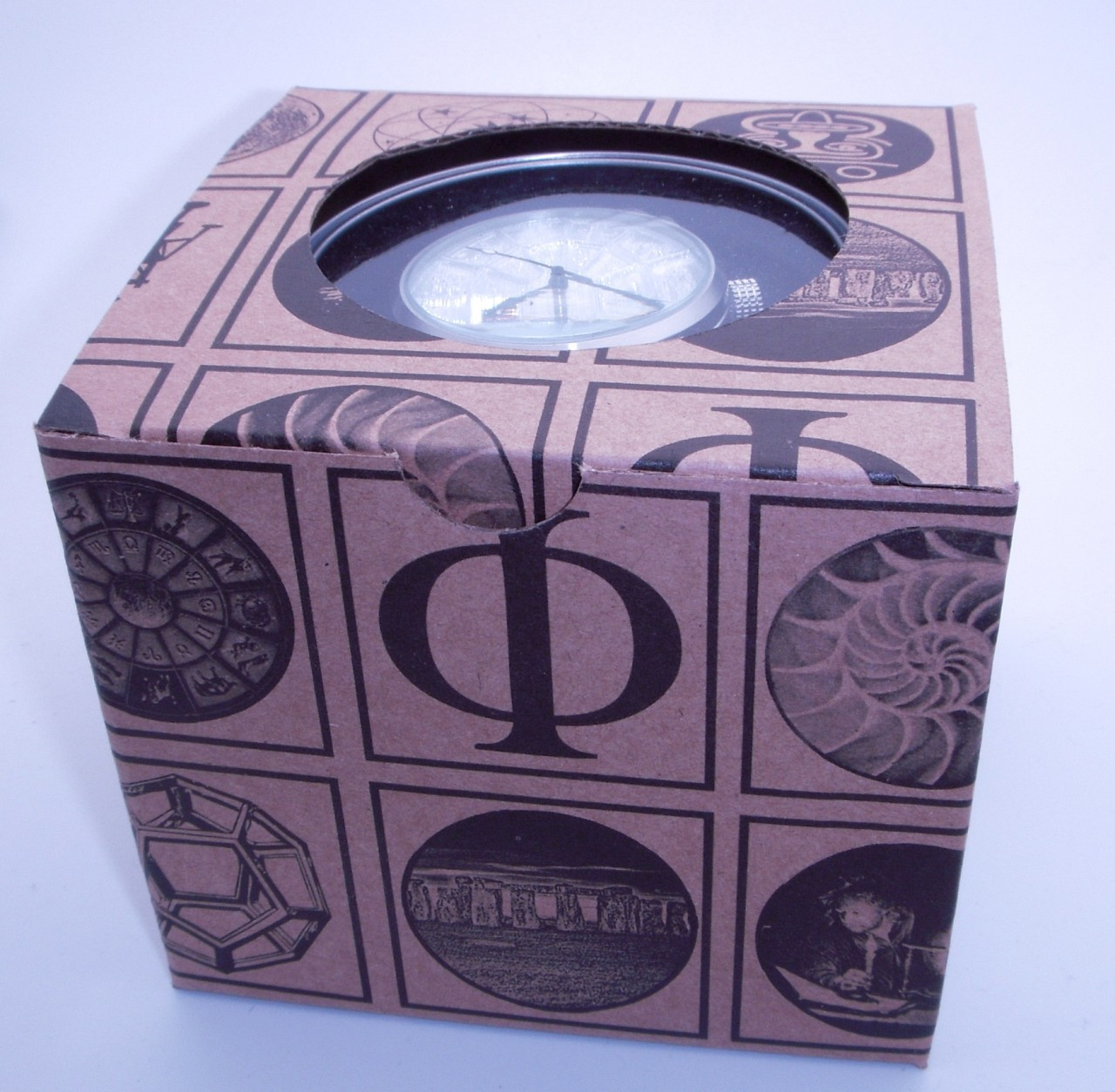 Tin box inside recycled paperboard sleeve