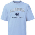 Carolina Blue Vintage Wrestling Tee - arc Carolina over an interlocking NC over Wrestling