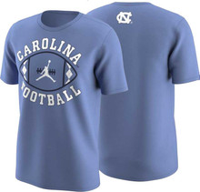 Carolina Blue tee with arc Carolina over a football icon and Football underneath.  The argyle is the side stripes on the ball and a Jumpman logo is in the middle.