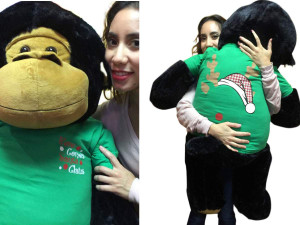 48-inch Big Plush Gorilla Wears 2-Sided Green Tshirt says Here Comes Santa Claus on Front and  Santa Hat and  Reindeer Antlers on Back
