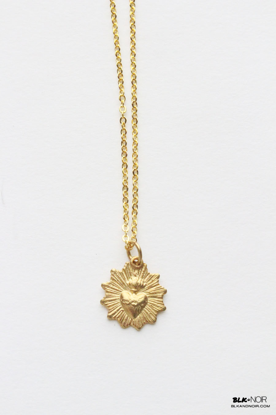The sacred heart necklace blk and noir here we have a new vintage style sacred heart necklace in gold the sacred heart charm is a piece from the 1800s that has been replicated into a 22k gold aloadofball Images