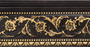 Beautifully finished in wood tone featuring raised floral pattern details accented in gold.